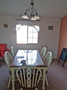 Original location the dinning table with the pink wall to the right